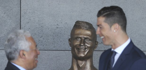 Cristiano Ronaldo with funny statue in Madeira air